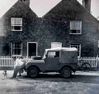 My Father, Mother, and Tim the dog with Landrover outside there House